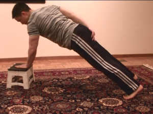 Low Incline One-Armed Pushup