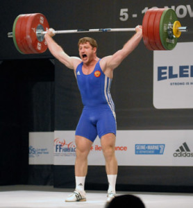 Man performing an Olympic Snatch